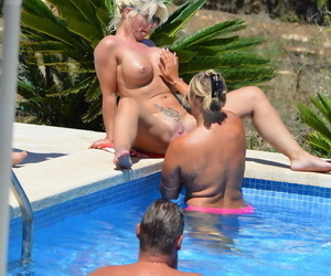 Mature amateur Sweet Susi has her cunt pleasured by a gf on the side of a pool