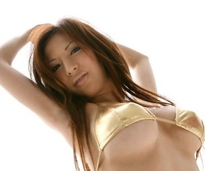 Japanese girl with a phat ass pinches her nipples while fondling big tits