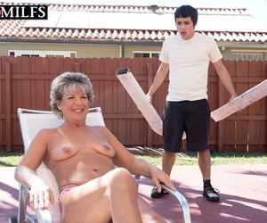 Imported mature woman Constance Happiness seduces the young deck boy