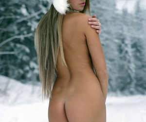 Hot blonde slut Verunka strips naked in the snow to model wearing only boots