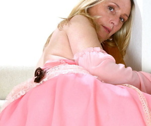 Middle-aged blonde in a Pirate Queen outfit reveals her pink cunt and clit