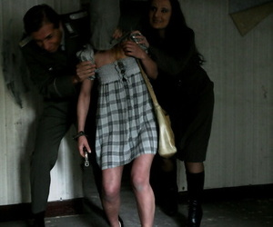 Young light-complexioned girl has the brush tits exposed by the brush jailers inside oubliette cell