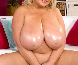 Naked BBW with blonde hair Samantha Sanders grabs her big oiled soaked boobs