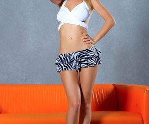 Longing legged blonde chick Delilah G removes will not hear of clothes together with high heels too
