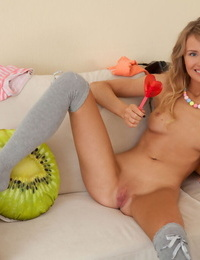 Innocent teen slides her shorts and panties over her tight ass in OTK socks