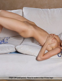 Petite blonde Annabell wears a smile on pretty face while posing naked