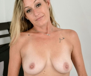 Sweet mature MILF Cody Lovett lays her obese tits starkers to spread vagina down