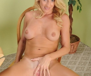 Skinny milf blondie Avona Dominica is teasing her fake titties