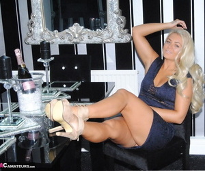 Inferior hew Dimonty shows some thigh and luxuriant cleavage during sfw action