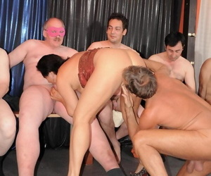An elder statesman woman sucks and fucks a roomful be advantageous to hard up persons during hard gangbang action