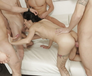 Inked chick Chris Diamond gangbanged by group of jizz shooting cocks