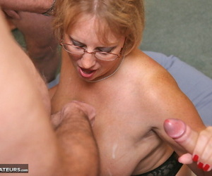 Big titted amateur Curvy Claire talks on cell as she begins a blowbang session