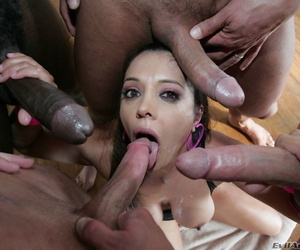 Pornstar Lucky Starr gets cum on her face from many men during a blowbang