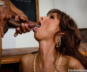 Hot mature teacher shares a mouthful of cum with her cuck after a DP in class