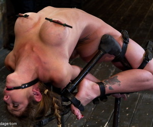 Helpless white girl is double over backwards in bondage and basically tortured