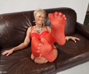 Blonde cougar Simone Sonay teasingly removes her red heels and nylons
