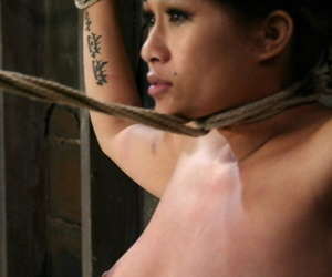 Naked Asian womanlike DragonLily endures electrocution with an increment of nipple torture in dungeon