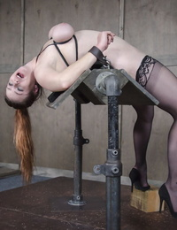 White girl Bella Rossi is forced to suck and fuck in extreme bondage setting