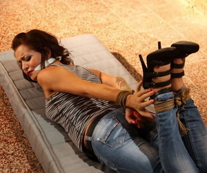 Distressed captive Adel hog tied & gagged fully clothed & helpless in basement