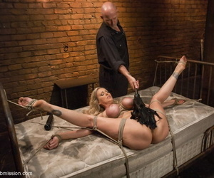 Busty confined up MILF Julia Ann gets her muff whipped and toyed to the black hole