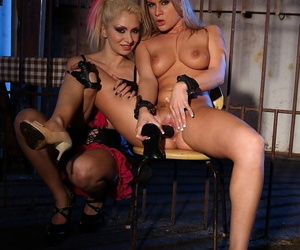 Blonde BDSM lovers Lea Lexis & Steffie engage in harsh dungeon toying session