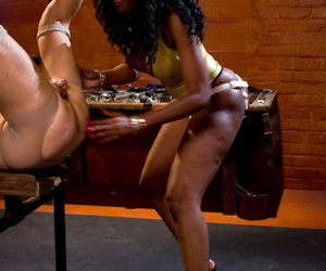 Gloomy Domme Nyomi Banxxx pegs a restrained male who sports a chastity gadget