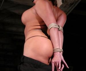 Guy in black skillfully stimulates twat of tied up MILF Ava Devine