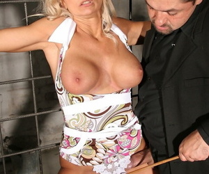 Mature blonde woman Winnie gets tied up and used by her kinky master