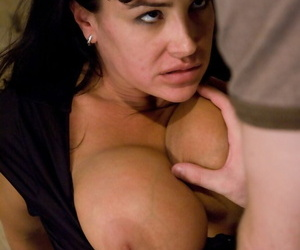 Big-boobied MILF Lisa Ann with bound hands and legs mouthfucked by James Deen