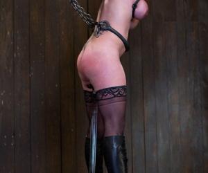 Busty female sub Felony has big boobs bound tight in painful metal bondage
