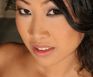 Smoking hot Asian babe Sharon Lee strips and unveils her big boobs