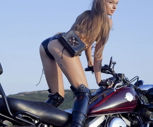 Subsistence teen Milena D shows her tiny tits plus penurious slit heavens a motorcycle