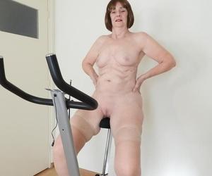 Hot granny Kat Kitty masturbates after riding vigour bike in tan stockings