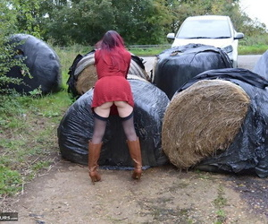 Horny mature Barby spreads ass in stockings & boots in naked outdoor upskirt