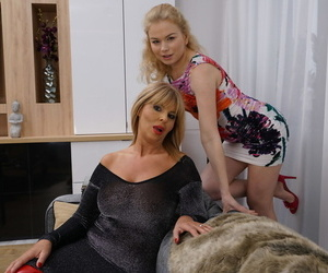 Older and younger blondes engage in lesbian sex upon a shared bed