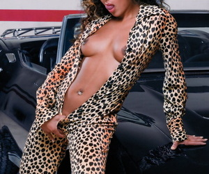 Sexy black girl unzips her animal print clothing before a DP atop a vehicle