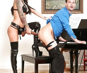 Brunette female Brandy Aniston inserting huge dildo into mans ass in boots