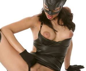 Sexy cosplay MILF Katty in leather catsuit spreading pussy lips wearing gloves