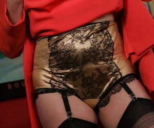 Mature woman removes red attire give model in aureate lingerie be worthwhile for a output era