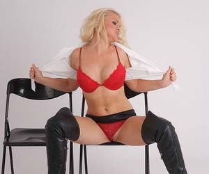Natural blonde lets a breast free of a red bra after donning leather OTK boots