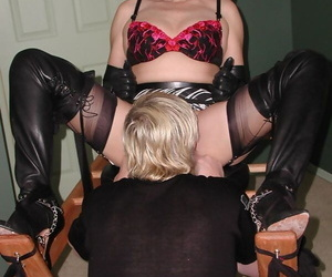 Older redhead Miss Abigail has her pussy flogged and licked while restrained