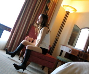 Cute Japanese teen Ayaka models in a red thong paired with black boots