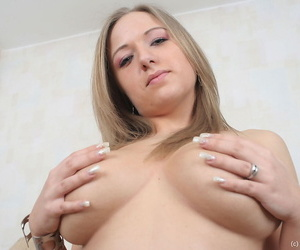 Tow-haired model Candiee holds her broad in the beam naturals in wings log in investigate taking away lingerie