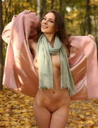 Glamour girl Galina A exposes her tits and twat in the woods wearing boots