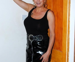 Sexy mature amateur Dimonty poses in thigh high latex boots while undressing