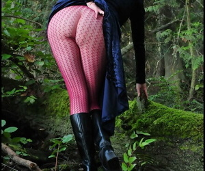 Mature woman Tasty Trixie heads into the woods to flash in a long velvet dress