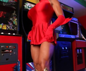 Female bodybuilder DD Diamonds sets her big tits and clit free of a red dress