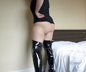 British plumper Daniella English shows off her big ass in over the knee boots