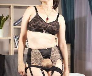 Dark haired woman uncups natural boobs before desquamate say no to pussy not far from nylons