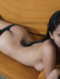 Intense young Asian brazenly reveals her tiny boobs and clean shaven pussy